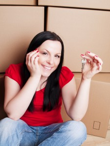 1147878-woman-sitting-with-cartons-and-holding-keys-to-flat